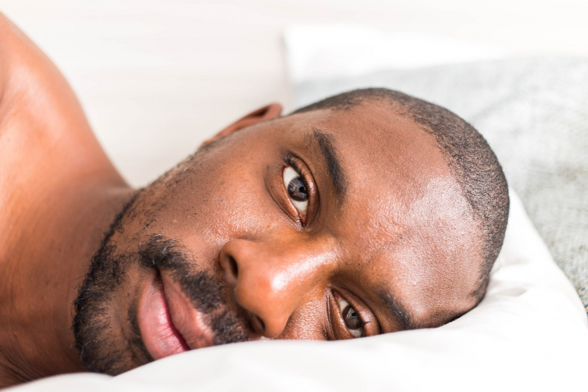 Man lays in a bed